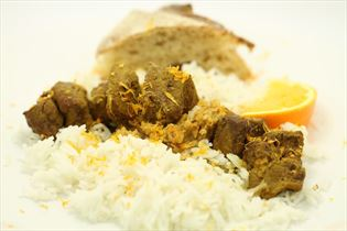 Ande-satay med ris og flute